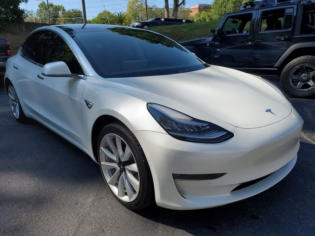 Tesla model 3 with full front end paint protection and tinted windows